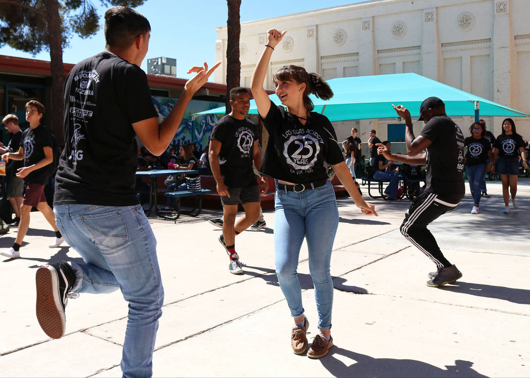 Las Vegas Academy students Oscar Federico, 16, left, and Annabella Huns, 16, dance together at lunch during the school's 25th anniversary day, Friday, Aug. 18, 2017. Gabriella Benavidez Las Vegas  ...