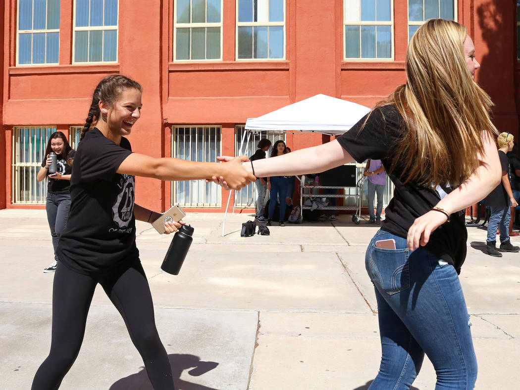 Las Vegas Academy students Katie Fiore, 15, left, and Kendal Owens, 15, dance together at lunch during the school's 25th anniversary day, Friday, Aug. 18, 2017. Gabriella Benavidez Las Vegas Revie ...