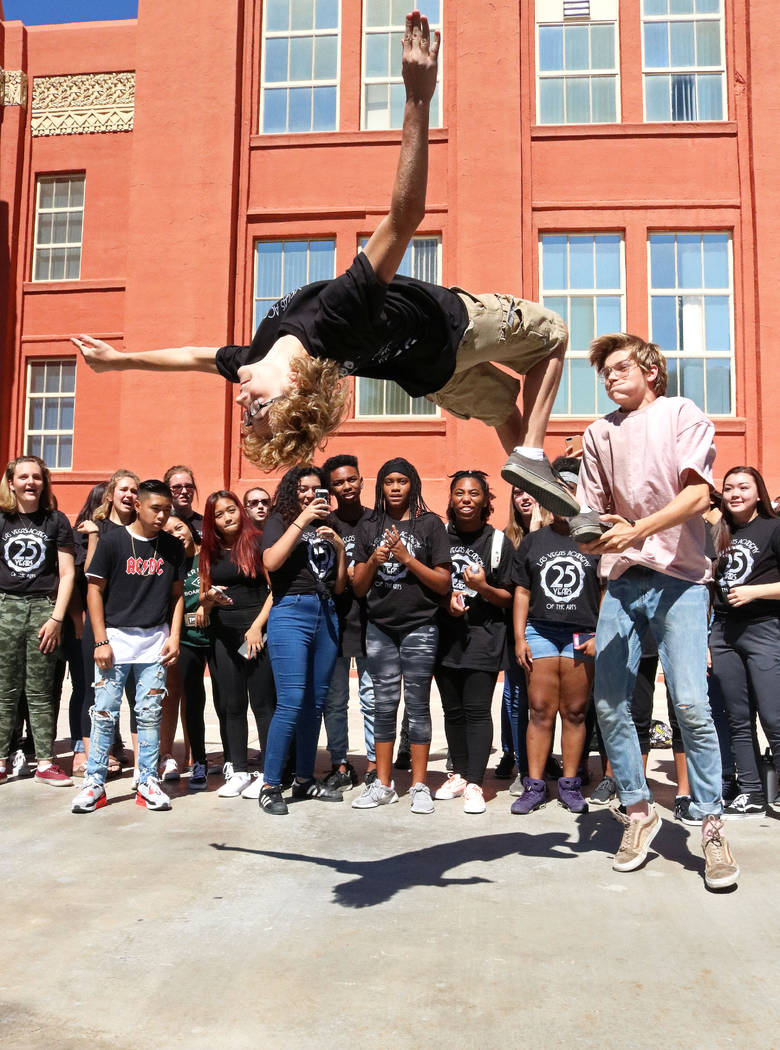 Las Vegas Academy student David Shay, 16, gets some help from classmate Mason Leech, 16, for a flip trick performance at lunch during the school's 25th anniversary day, Friday, Aug. 18, 2017. Gabr ...
