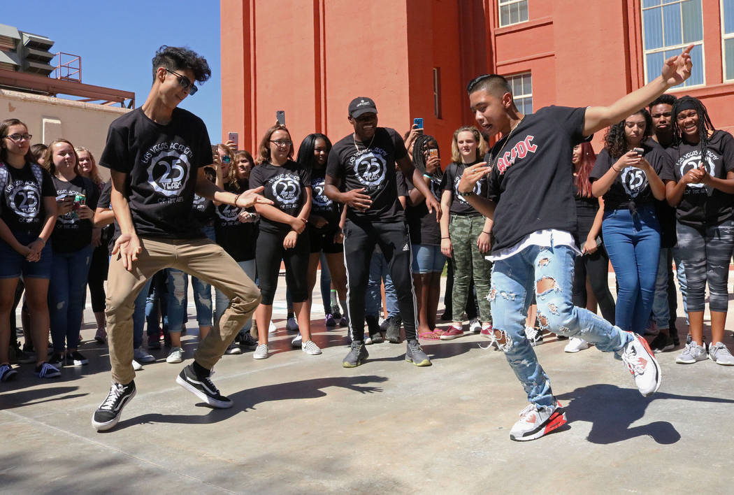 Las Vegas Academy students Ryan Counch, 17, left, and Bailey Munoz, 17, dance off to one another at lunch during the school's 25th anniversary day, Friday, Aug. 18, 2017. Gabriella Benavidez Las V ...