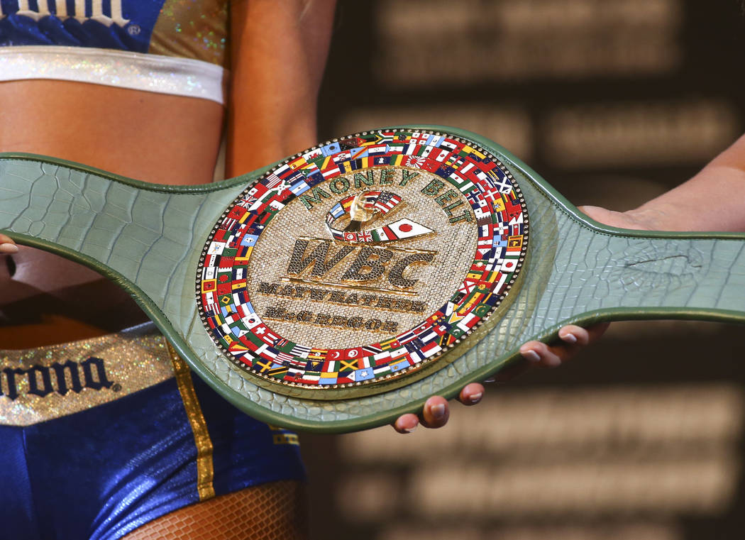 "The World Boxing Council belt, called ""The Money Belt, is shown during the final press conference ahead of the fight featuring Floyd Mayweather Jr. and Conor McGregor, slated for Aug. 26  ..."