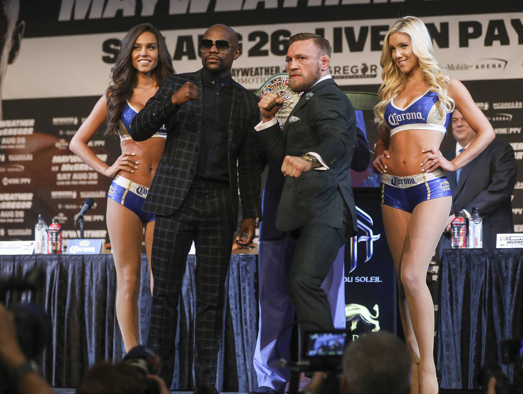 Floyd Mayweather Jr., left, and Conor McGregor during the final press conference ahead of their fight, slated for Aug. 26 at the T-Mobile Arena, at the Ka Theatre at the MGM Grand in Las Vegas on  ...