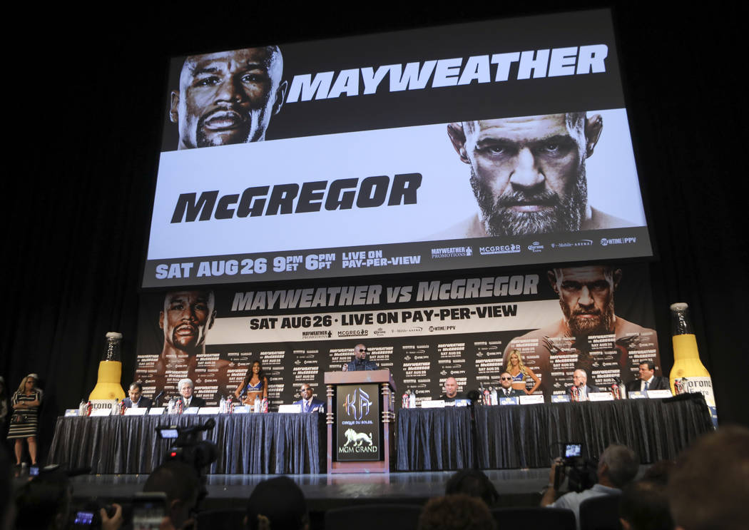 Floyd Mayweather Jr., center, during the final press conference ahead of his fight against Conor McGregor, slated for Aug. 26 at the T-Mobile Arena, at the Ka Theatre at the MGM Grand in Las Vegas ...