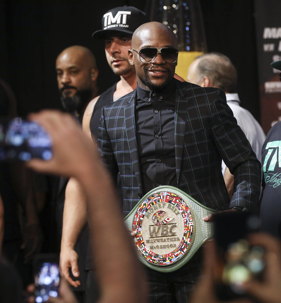 "Floyd Mayweather Jr. with ""The Money Belt"" during the final press conference ahead of their fight, slated for Aug. 26 at the T-Mobile Arena, at the Ka Theatre at the MGM Grand in ..."