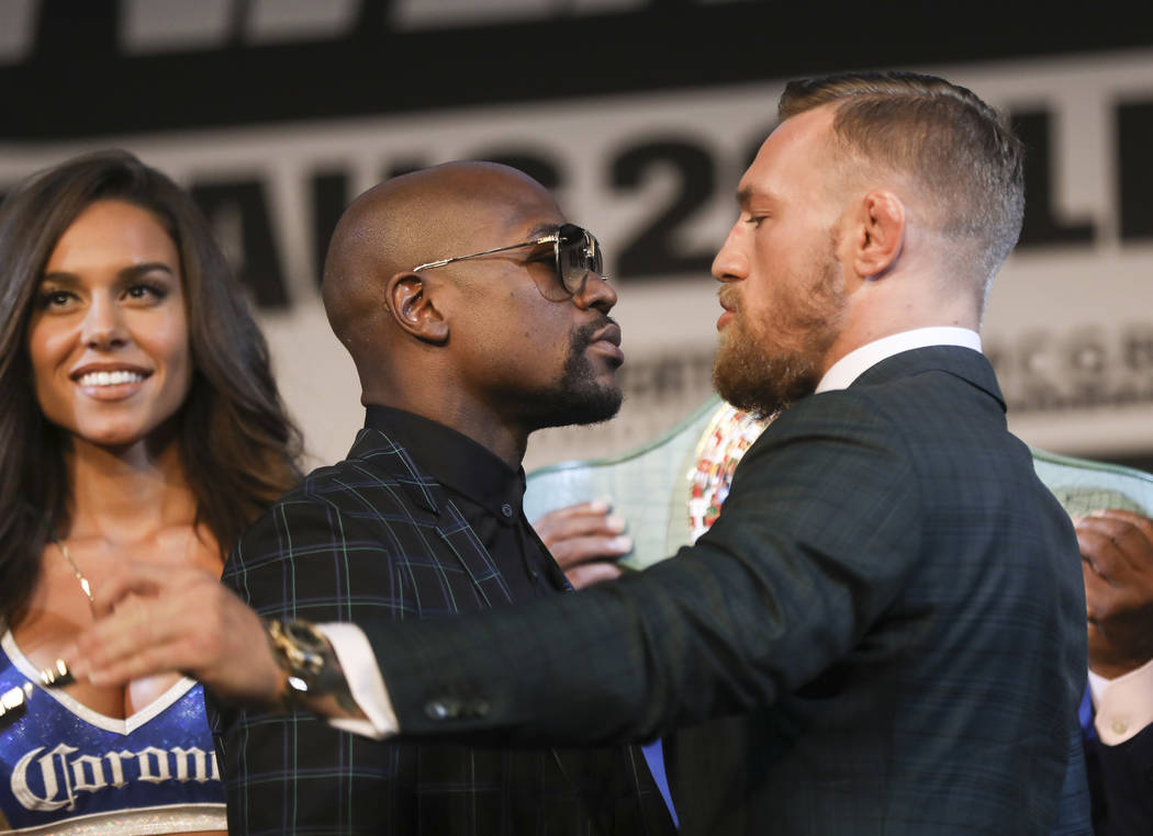 Floyd Mayweather Jr., left, and Conor McGregor face off during the final press conference ahead of their fight, slated for Aug. 26 at the T-Mobile Arena, at the Ka Theatre at the MGM Grand in Las  ...