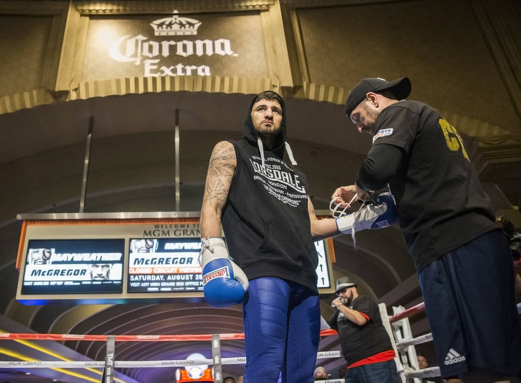 Light heavyweight boxer Nathan Cleverly, left, gets his hands wrapped before open workouts on Wednesday, Aug 23, 2017, at the MGM Grand casino-hotel, in Las Vegas. Benjamin Hager Las Vegas Review- ...