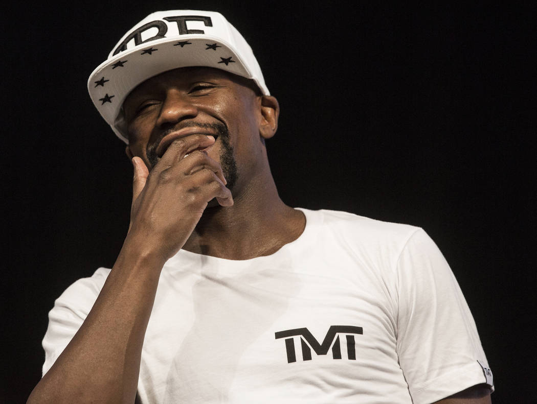 Floyd Mayweather Jr. laughs at Conor McGregor's antics during weigh-ins on Friday, Aug 25, 2017, at T-Mobile Arena, in Las Vegas. Benjamin Hager Las Vegas Review-Journal @benjaminhphoto
