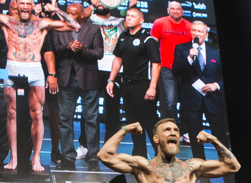 Conor McGregor pumps up the crowd as he steps on the scale during weigh-ins on Friday, Aug 25, 2017, at T-Mobile Arena, in Las Vegas. Benjamin Hager Las Vegas Review-Journal @benjaminhphoto