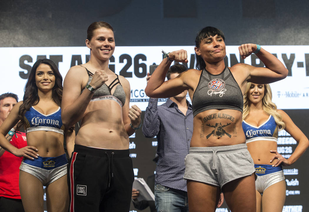 Savannah Marshall, left, faces off with Sydney LeBlanc during weigh-ins on Friday, Aug 25, 2017, at T-Mobile Arena, in Las Vegas. Benjamin Hager Las Vegas Review-Journal @benjaminhphoto