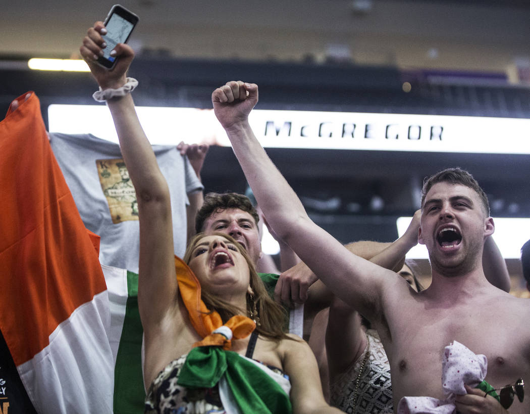 Fans of Conor McGregor cheer as he's announced during weigh-ins for Saturday's Mayweather McGregor fight on Friday, Aug 25, 2017, at T-Mobile Arena, in Las Vegas. Benjamin Hager Las Vegas Review-J ...