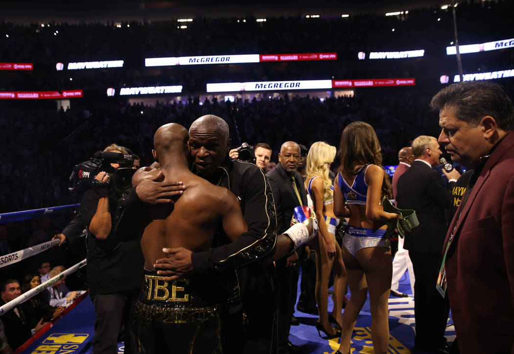 Floyd Mayweather Jr., left, hugs his father, Floyd Mayweather, before his fight against Conor McGregor at T-Mobile Arena, Saturday, Aug. 26, 2017, in Las Vegas. Benjamin Hager Las Vegas Review-Journal