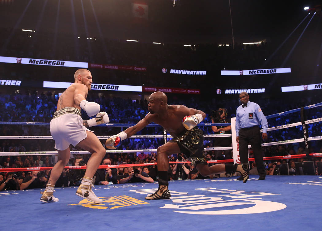 Conor McGregor, left, and Floyd Mayweather Jr. during the first round of their fight at T-Mobile Arena, Saturday, Aug. 26, 2017, in Las Vegas. Benjamin Hager Las Vegas Review-Journal