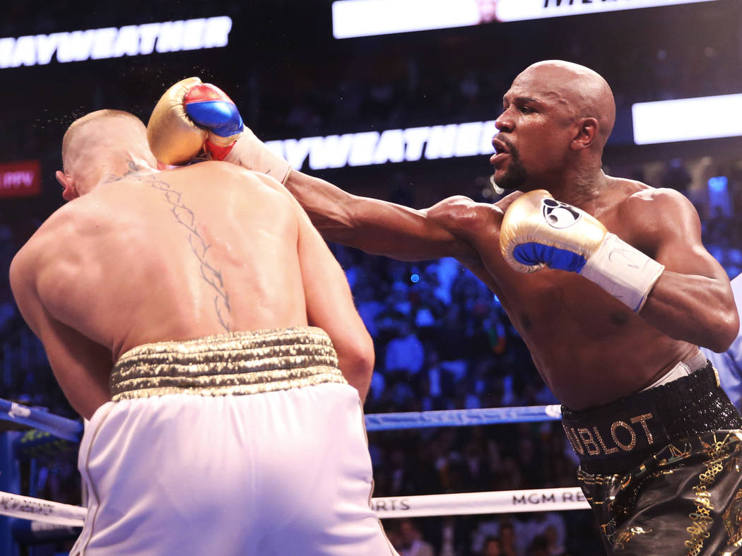 Floyd Mayweather, right, lands a punch against Conor McGregor in the blank round on Saturday, Aug 26, 2017, at T-Mobile Arena, in Las Vegas. Benjamin Hager Las Vegas Review-Journal @benjaminhphoto