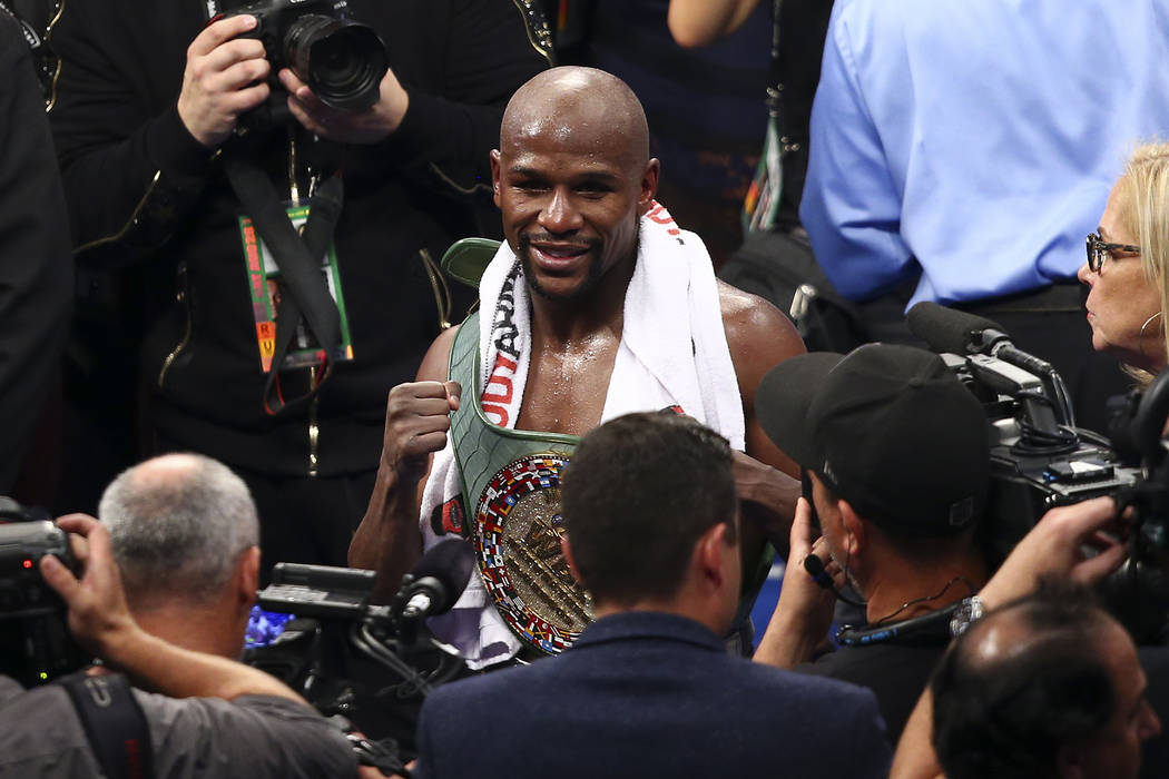 Floyd Mayweather Jr. after defeating Conor McGregor in their super welterweight fight at T-Mobile Arena, Saturday, Aug. 26, 2017, in Las Vegas. Mayweather won via 10th round technical knockout. Ch ...