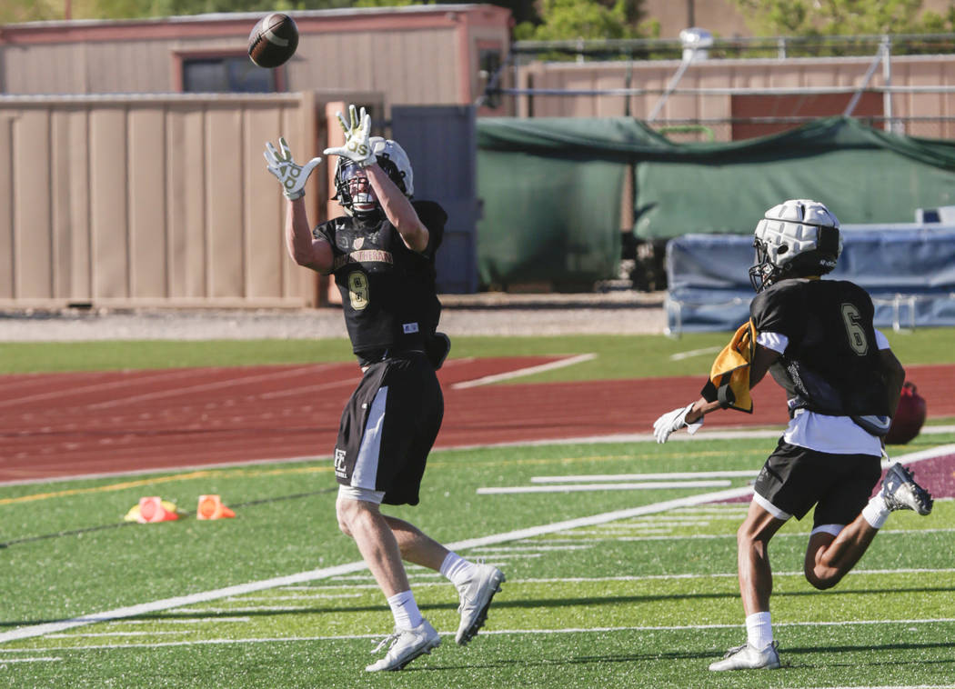 Faith Lutheran wide receiver Elija Kothe (8) catches a pass after bypassing corner back Myles Price (6) during practice at Faith Lutheran High School in Las Vegas, on Monday, Aug. 21, 2017.  Gabri ...