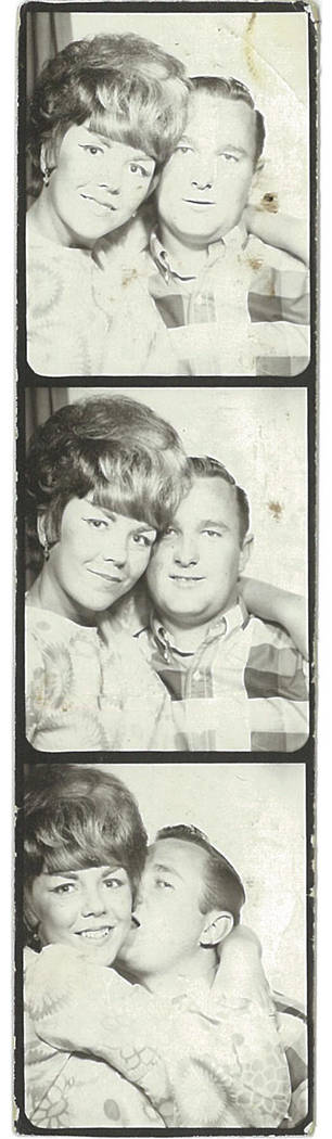 Claudia Reott and David Denevan sit in a photo booth on their wedding day, Aug. 25, 1965. (Claudia Reott and David Denevan)
