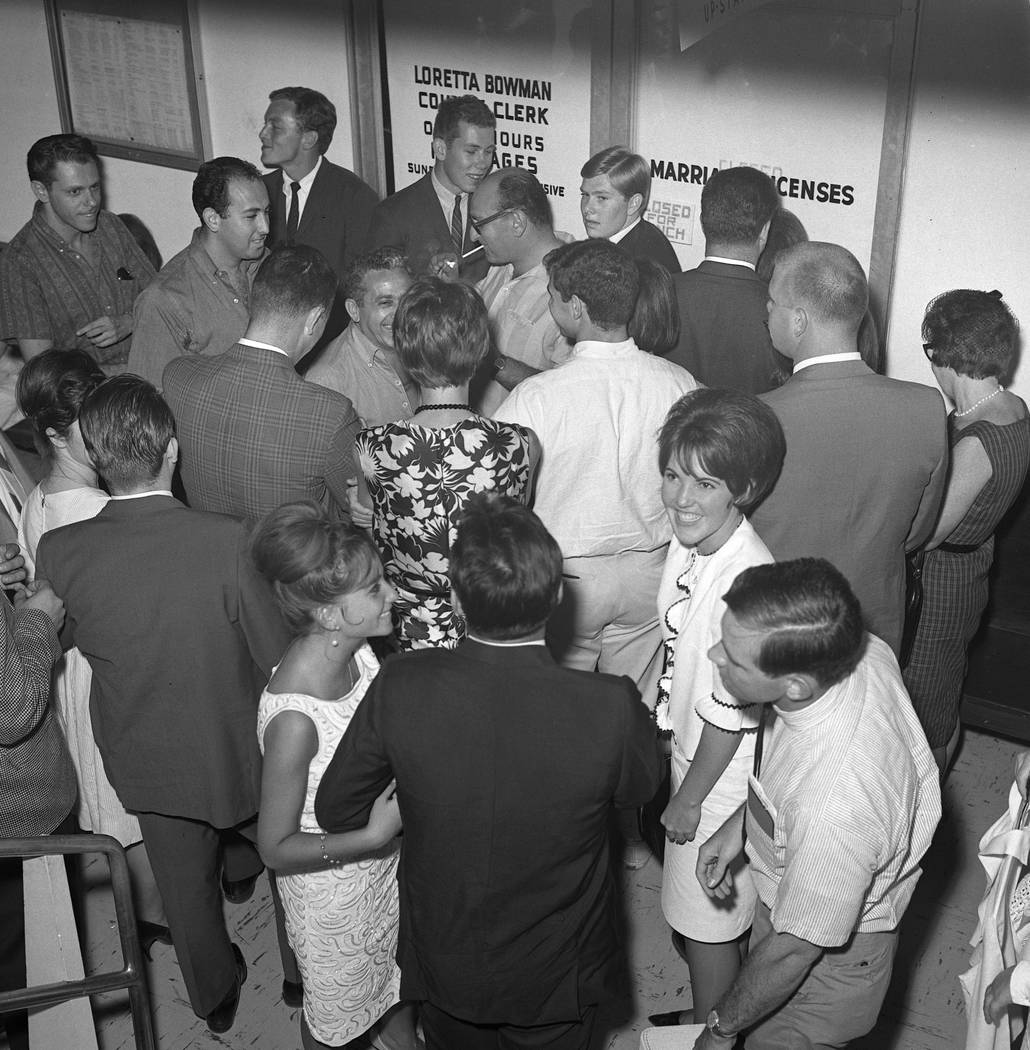 Couples rush to secure a marriage license and get married ahead of a military draft deadline, Aug. 25, 1965. (Milt Palmer/Las Vegas News Bureau)