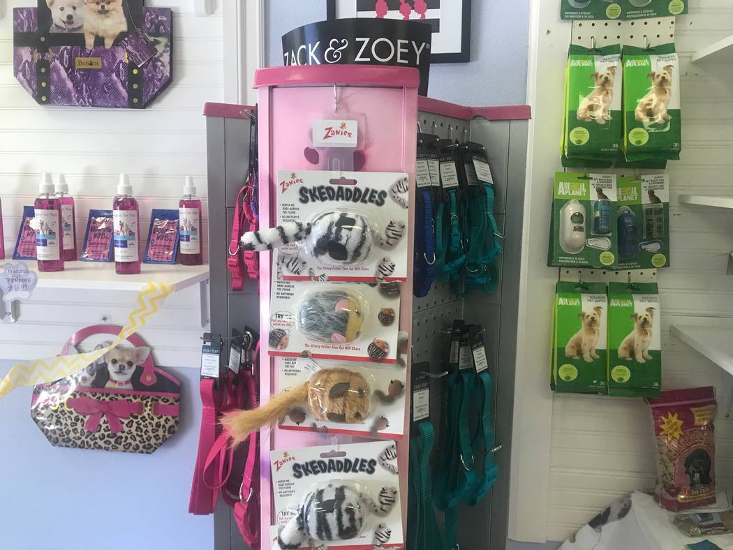 Supplies for sale are displayed on August 19, 2017 at Kimberly's Passion for Paws, shaving dog on August 19, 2017 at 3940 N. M.L.K. Blvd. (Kailyn Brown/ View)