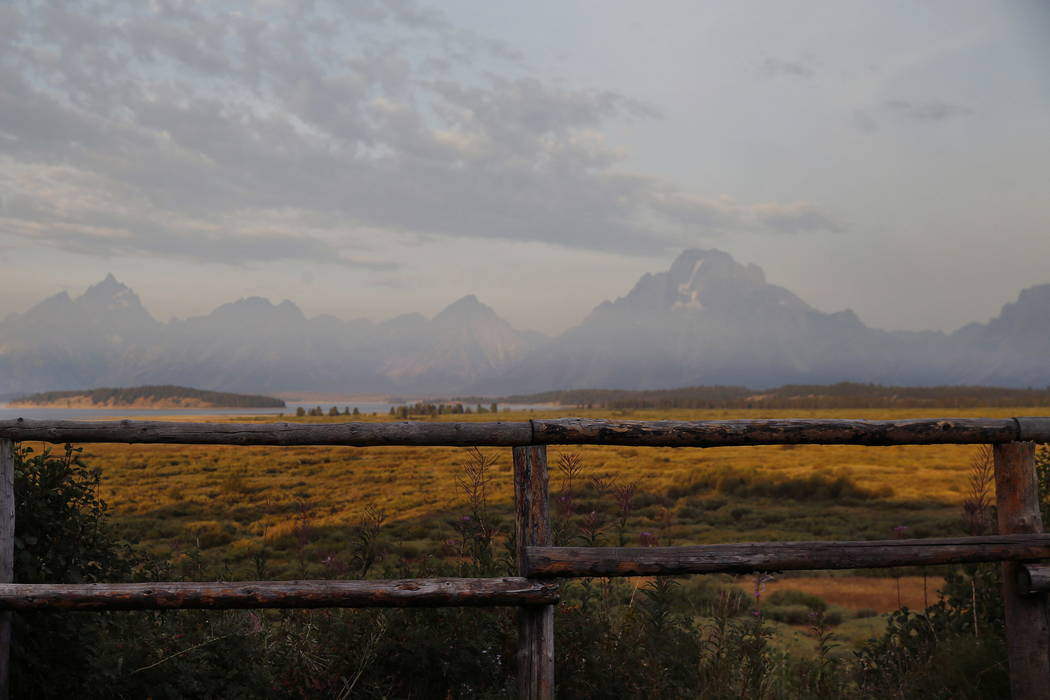 The sun illuminates the Grand Tetons in Grand Teton National Park, north of Jackson Hole, Wyo., in 2016.  (AP Photo/Brennan Linsley, File)