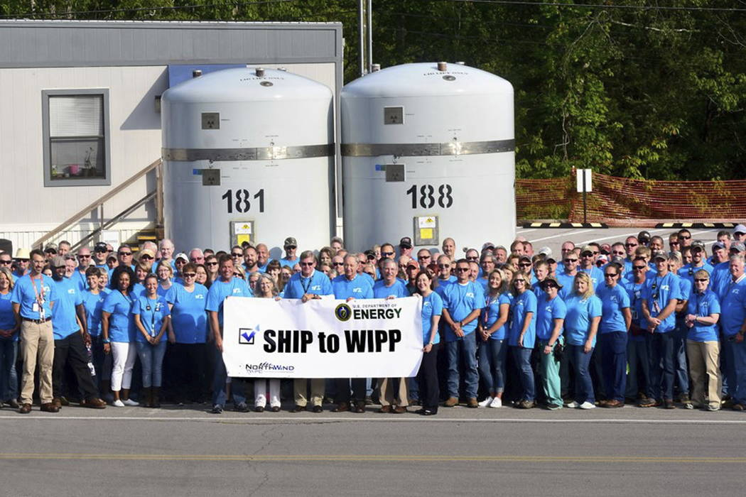 A group of employees at Oak Ridge National Laboratory in Tennessee celebrates after seeing off the first shipment in five years of radioactive waste to the federal government's underground reposit ...