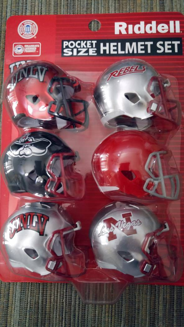 UNLV is offering these mini helmets to its season-ticket holders. Photo by Mark Anderson/Las Vegas Review-Journal.