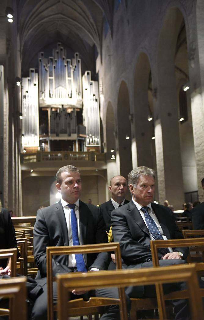 President of Finland Sauli Niinist and Finland's Minister of Finance Petteri Orpo, left, attend a prayer service for stabbing victims at the Cathedral in Turku, Finland, on Friday evening, Aug. 18 ...