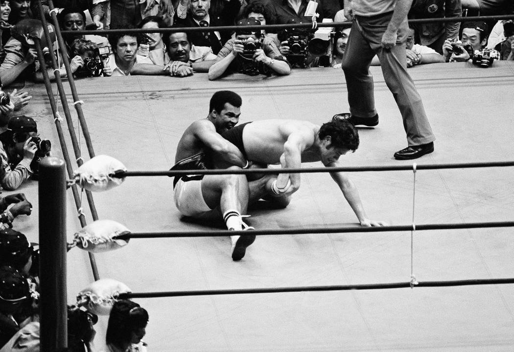 Muhammad Ali holds wrestler Antonio Inoki from the back in the fifth round Saturday, June 26, 1976 in Tokyo. The boxing-wrestling bout ended in a draw. (AP Photo/TM)