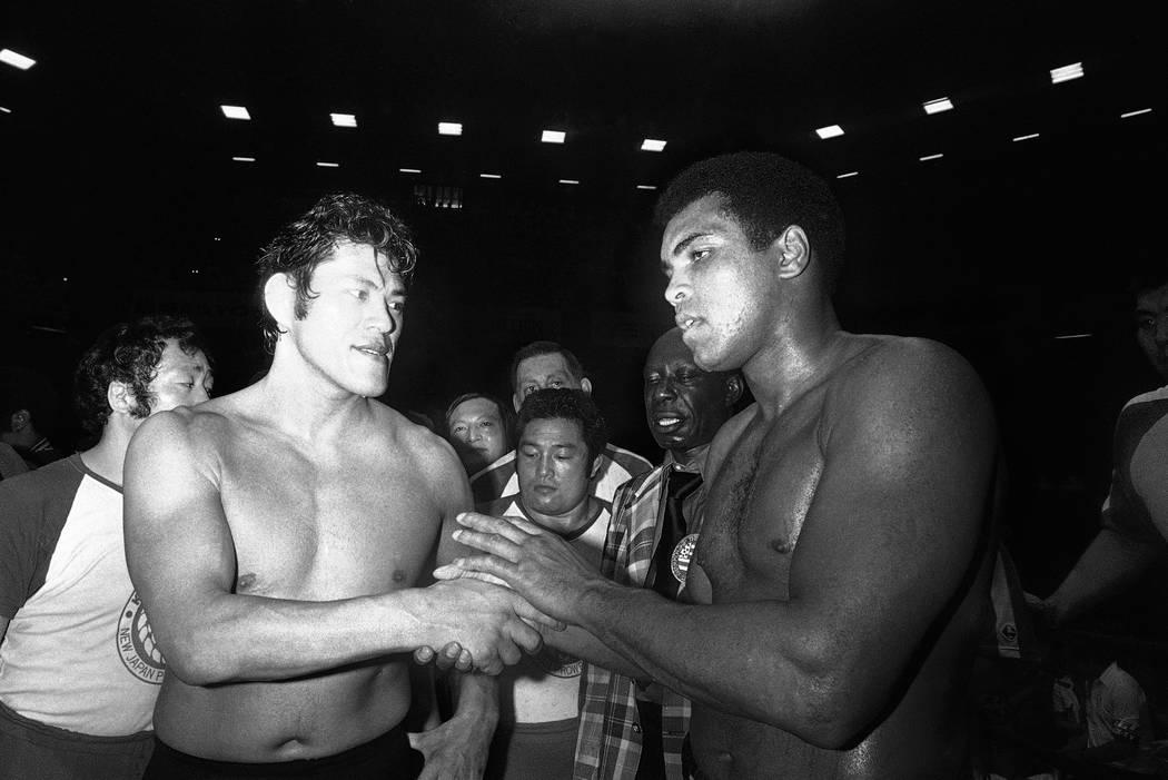 Wrestler Antonio Inoki, left, and world heavyweight boxing champion Muhammad Ali shake hands after a 15-round boxing- wrestling fight held on Saturday, June 26, 1976 at Tokyo?s Budckan Hall. Ali s ...