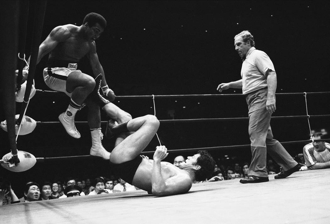 Muhammad Ali is evading Antonio Inoki on the corner in the 4th round of their scheduled 15 round bout at Budokan Hall, in Tokyo on Saturday, June 26, 1976. (AP Photo)