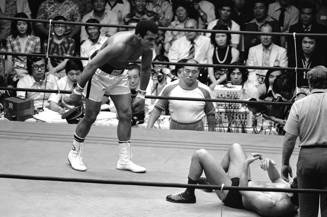 Muhammad Ali sticks his tongue out at Antonio Inoki as the Japanese wrestler keeps out of range of the world heavyweight boxing champion?s attack during the third round of their 15-round boxing-wr ...