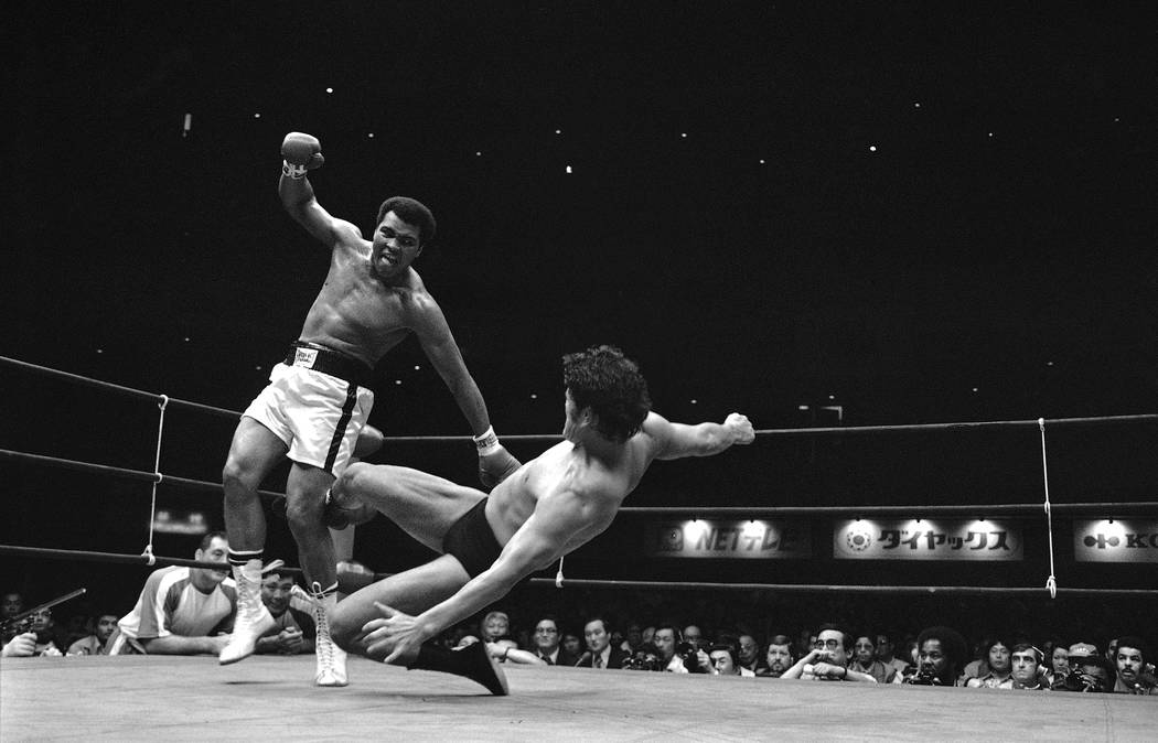 Antonio Inoki kicks Muhammad Ali to pull him down on the canvas 8th round of their 15-round of the World Martial Arts Championship fight in Tokyo on Saturday, June 26, 1976.  Both fighters fought  ...