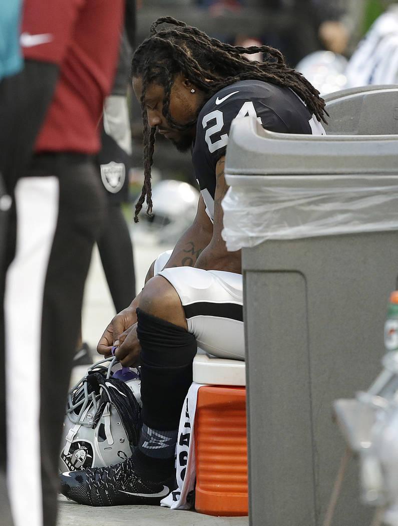 Oakland Raiders running back Marshawn Lynch sits on the bench during the national anthem before an NFL preseason football game  against the Los Angeles Rams in Oakland, Calif., Saturday, Aug. 19,  ...