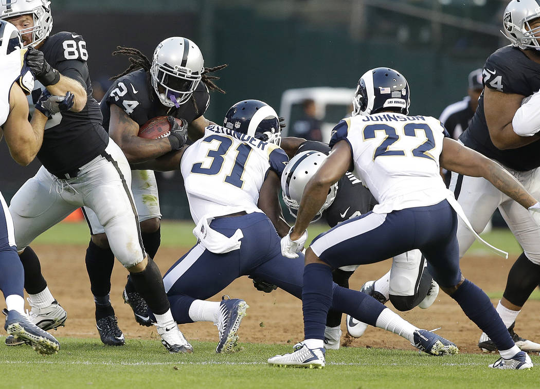 Oakland Raiders running back Marshawn Lynch (24) runs during the first half of an NFL preseason football game against the Los Angeles Rams in Oakland, Saturday, Aug. 19, 2017. (AP Photo/Rich Pedro ...