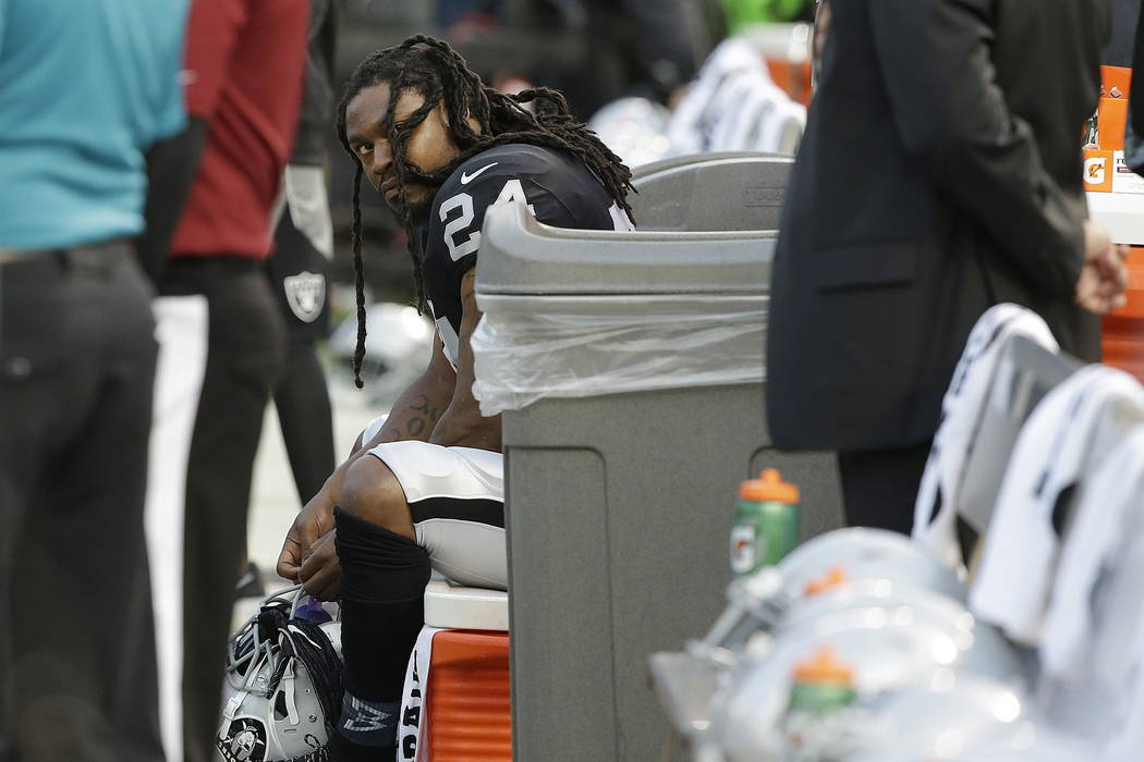 Oakland Raiders running back Marshawn Lynch sits on the bench during the national anthem before an NFL preseason football game against the Los Angeles Rams in Oakland, Calif., Saturday, Aug. 19, 2 ...