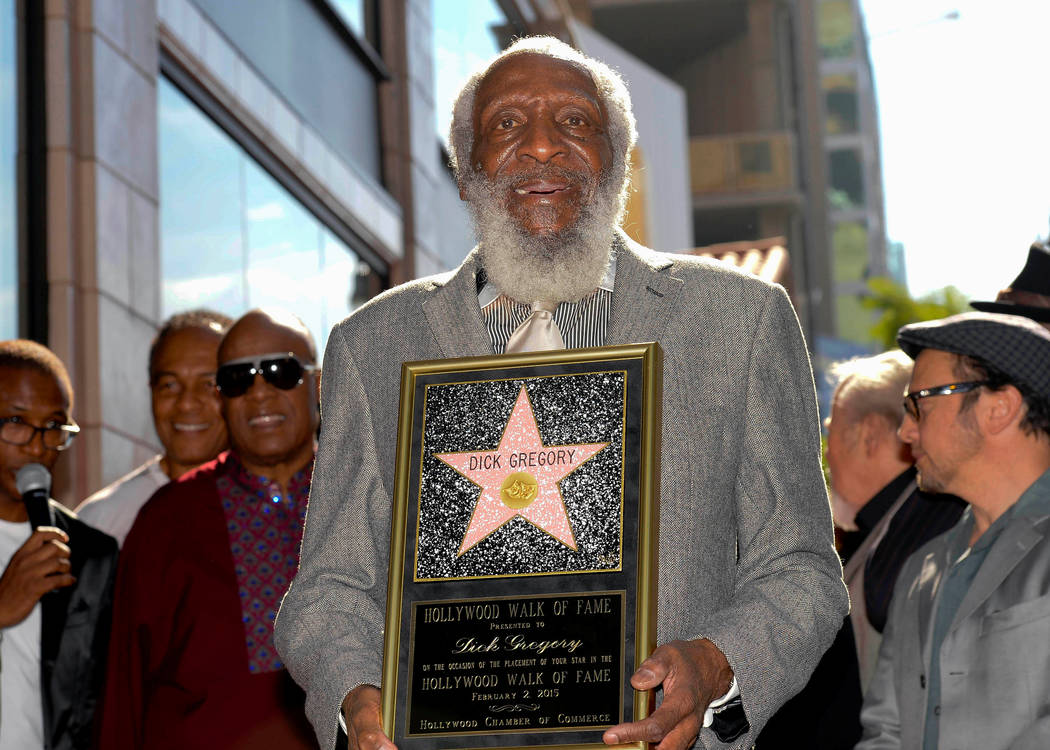 Comedian Dick Gregory receives his star on Star on the Hollywood Walk of Fame in Los Angeles, California February 2, 2015. REUTERS/Gus Ruelas/File Photo