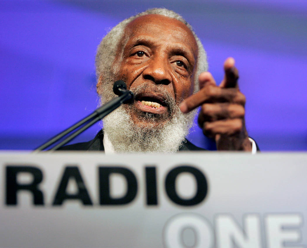 Comedian, social activist, writer and entrepreneur Dick Gregory speaks at the 25th Anniversary Gala of Radio One in Washington August 17, 2006. REUTERS/Joshua Roberts/File Photo