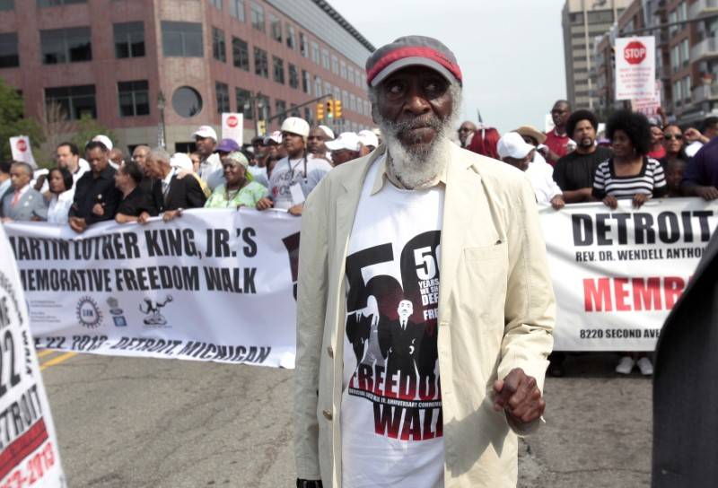 Comedian and social activist Dick Gregory marches down Woodward Avenue during the 50th Anniversary Commemorative Freedom Walk in Detroit, Michigan June 22, 2013.  REUTERS/Rebecca Cook