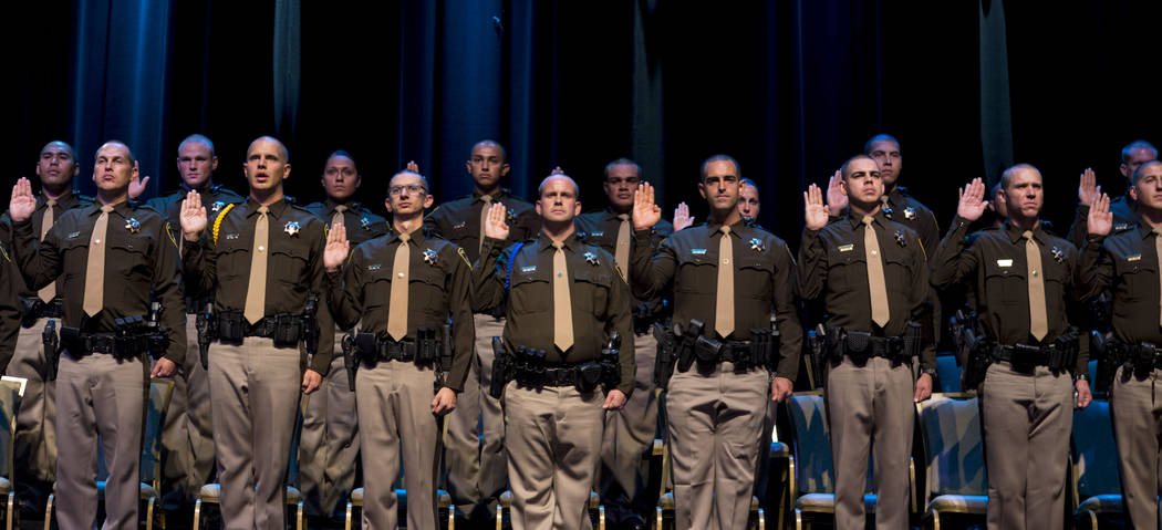 The 2017 graduates of the Metropolitan Police Department raise their hands in an oath during their graduation ceremony at The Orleans in Las Vegas on Monday, Aug. 21, 2017. Elizabeth Brumley Las V ...