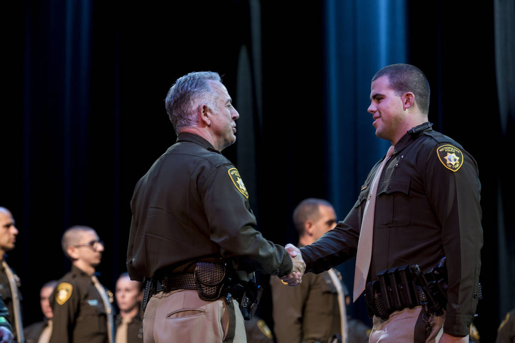 Sheriff Joseph Lombardo congratulates officer William Hutchings during the Metropolitan Police Department graduation ceremony at The Orleans in Las Vegas on Monday, Aug. 21, 2017. Elizabeth Brumle ...
