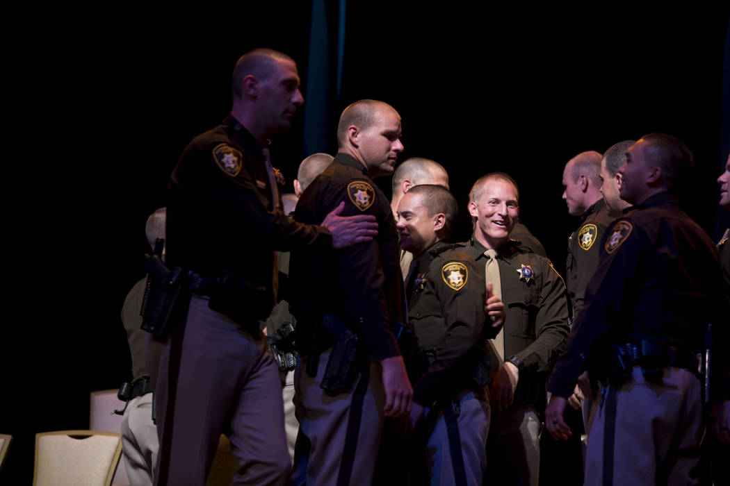 The 2017 graduating class of the Metropolitan Police Department smiles as its graduation ceremony ends at The Orleans in Las Vegas on Monday, Aug. 21, 2017. Elizabeth Brumley Las Vegas Review-Journal