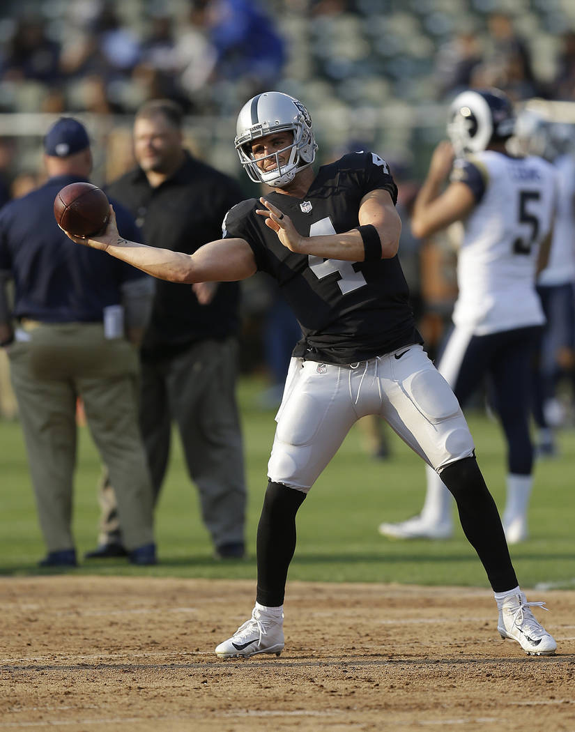Oakland Raiders quarterback Derek Carr before an NFL preseason football game against the Los Angeles Rams in Oakland, Saturday, Aug. 19, 2017. (AP Photo/Ben Margot)