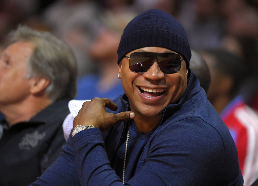 Rapper/actor LL Cool J watches the Los Angeles Clippers play the Utah Jazz during the first half of an NBA basketball game Nov. 3, 2014, in Los Angeles. (Mark J. Terrill/File, AP)