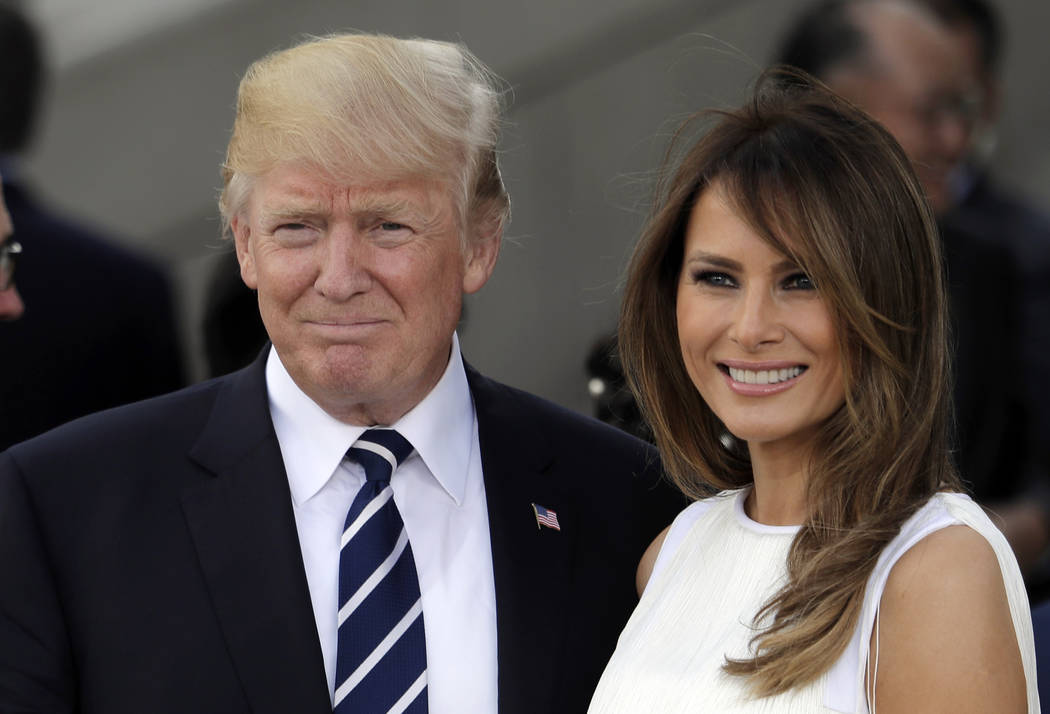 President Donald Trump, left, and first lady Melania Trump smile before a concert on the first day of the G-20 summit in Hamburg, northern Germany, July 7, 2017. The White House has announced that ...
