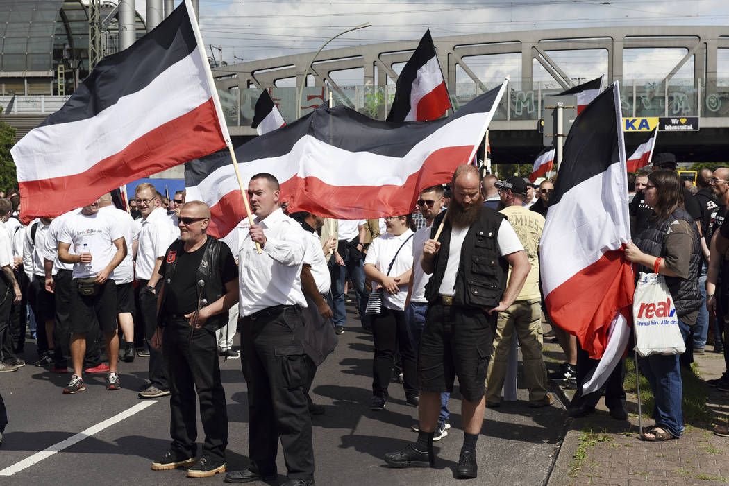 Far-right extremists gather to commemorate the death of Adolf Hitler's deputy, Rudolf Hess, in Berlin's western district  of Spandau, Saturday, Aug. 19, 2017. Police allowed the march, but partici ...
