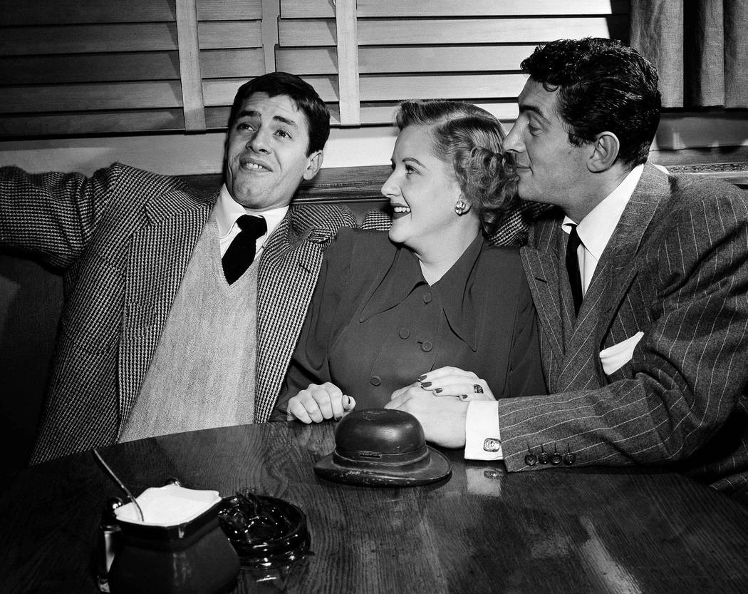 In this Jan. 21, 1949 file photo, big band singer Margaret Whiting is flanked by Jerry Lewis, left, and Dean Martin at the Hollywood Brown Derby on  in Los Angeles. Whiting, the sweet-voiced singe ...