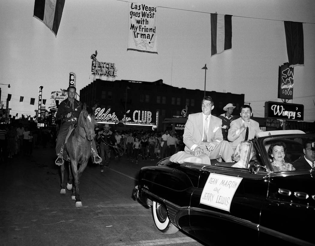 Dean Martin and Jerry Lewis ride down Main Street of Las Vegas on April 5, 1953, enroute to theatre for premiere of latest film. Parts of the picture were made in the gambling-resort city and a pa ...