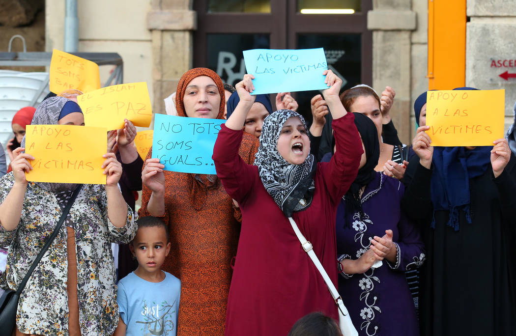 Relatives of suspects of the attacks in Barcelona and Cambrils gather with members of the local Muslim community as they take part in a rally to denounce terrorism in front of Ripoll's townhall, n ...