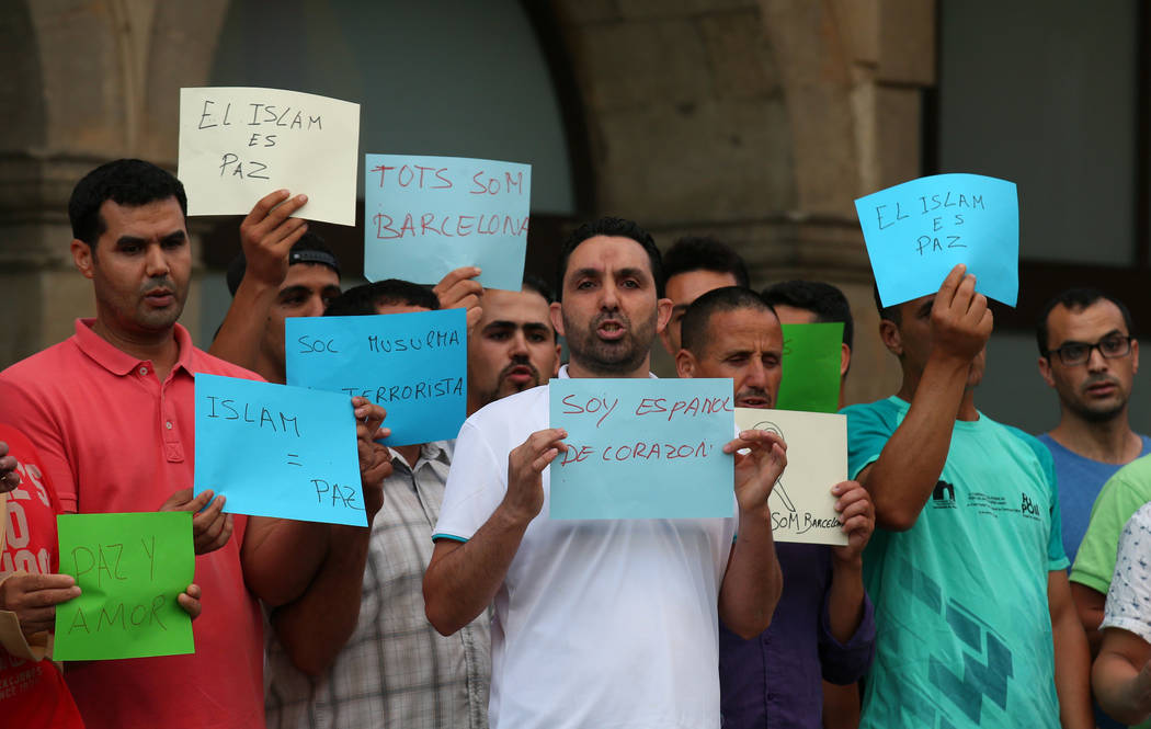 Islamic community Annour of Ripoll's President Ali Yassine (C) and relatives of suspects of the attacks in Barcelona and Cambrils gather with members of the local Muslim community as they take par ...