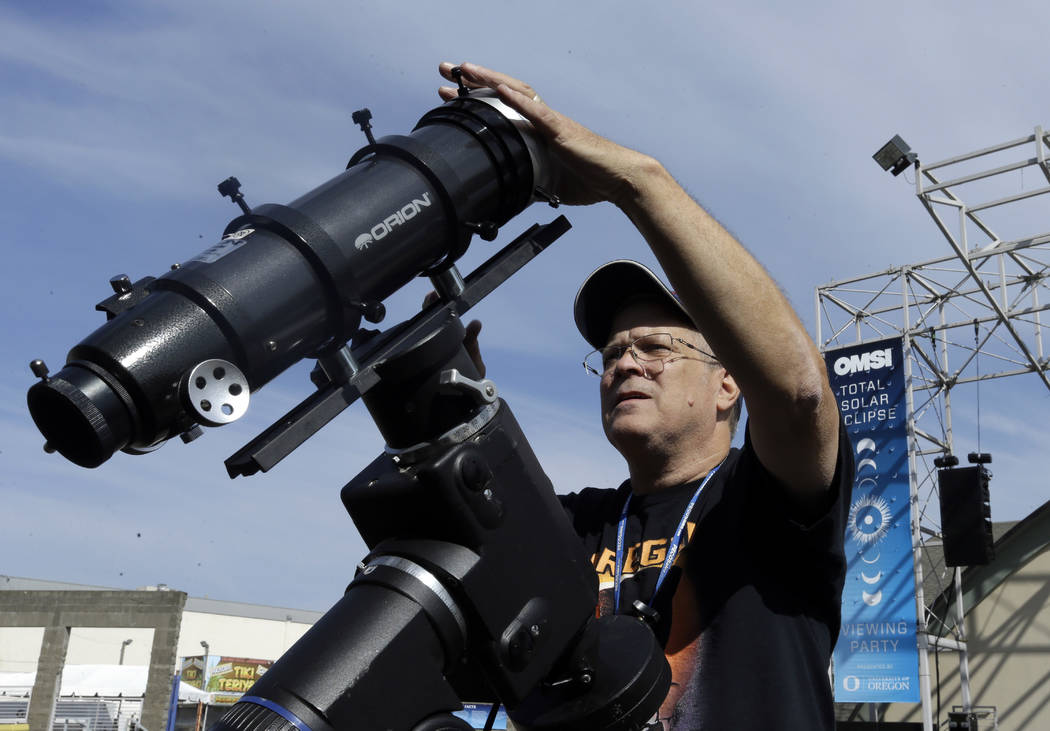 Ray Cooper, volunteer for the Oregon Museum of Science and Industry, preps his equipment to provide live video of the Aug. 21, 2017, solar eclipse at the state fairgrounds in Salem, Ore., Sunday,  ...