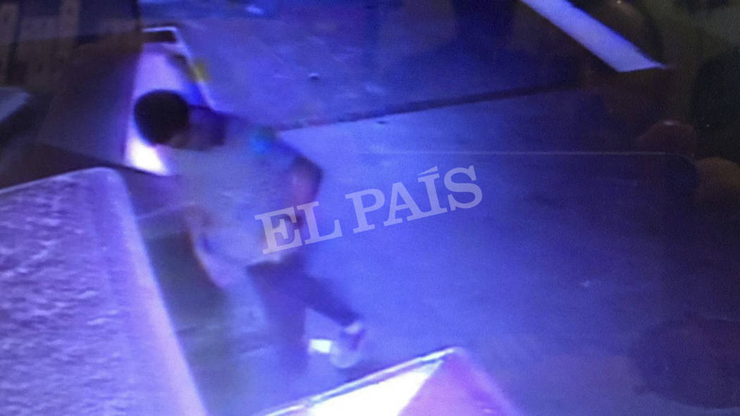 In this watermarked frame grab from CCTV released by the Spanish newspaper El Pais on Monday Aug. 21, 2017, a suspect believed to be Younes Abouyaaqoubis is captured by a security camera walking t ...
